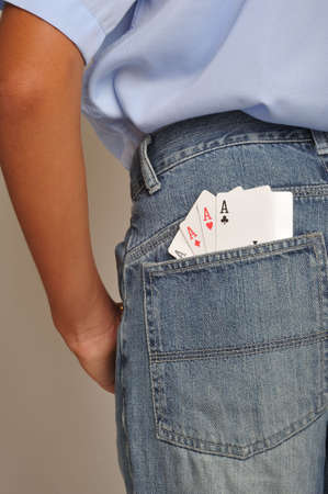 luckiness: Close up of four aces in back pochet jeans Stock Photo