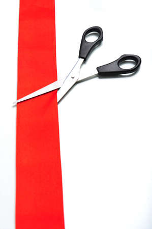 snip: A snip cutting a red ribbon, on white background