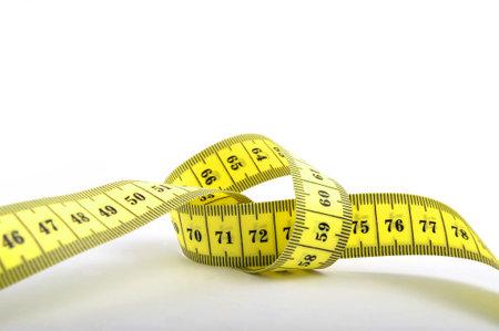 cintas metricas: Nudo atado en la cinta de medir Foto de archivo
