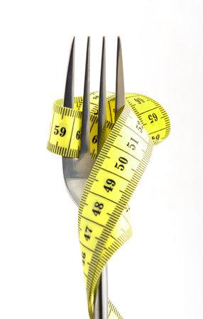 cintas metricas: Simple tenedor de color amarillo con cinta de medir