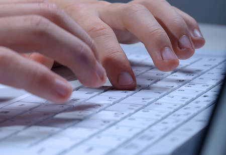 Close up of man hands typing on laptop keyboard Stock Photo - 4464173
