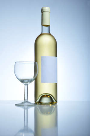 withe: A bootle of white wine and an empty glass Stock Photo