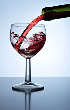 Red wine poured into wine glass, close up Stock Photo - 4498680