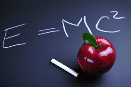 relativity: Red apple and Einstein relativity formula on blackboard