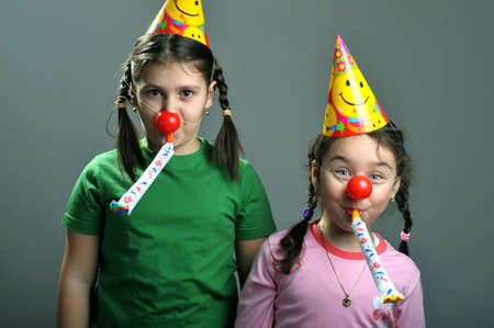 Two girls with party horn blowing in blowers Stock Photo - 4581992