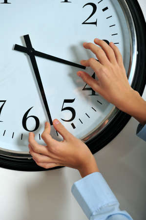 manipulating: Business man hands manipulating hands of clock
