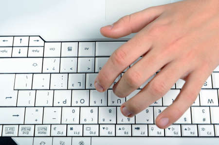 Man hands typing on laptop keyboard, top view Stock Photo - 4568455