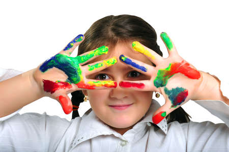 creativeness: Little girl with hands dirty with paint Stock Photo
