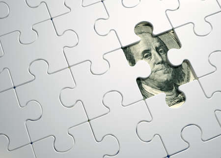 Puzzle pieces on dollar - this is a 3d render illustration
