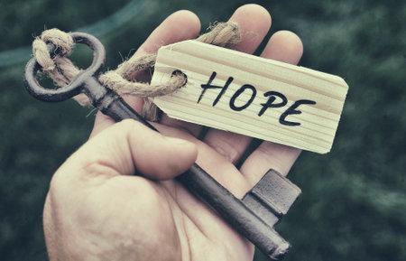 Key and label. Hope concept Foto de archivo