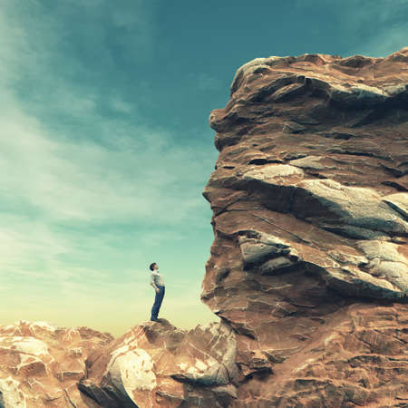Young man standing on edge of rock mountain and looking for big rock. This is a 3d render illustration Stock fotó