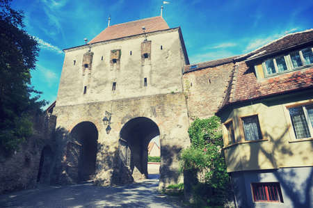 Historic tower gate in of the Fortress Sighisoara in Romania, Transylvania Фото со стока