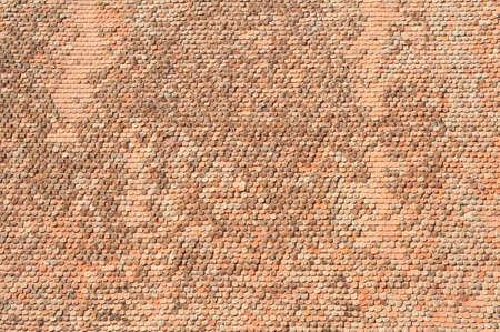 Old roof tiles texture as architecture background
