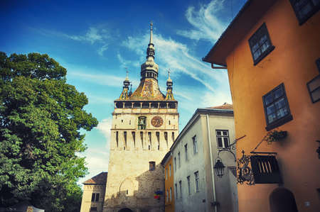Buildings medieval and clock tower in the citadel of Sighisoara in Romania - Transylvania,