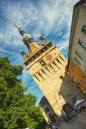 View to the clock tower in Sighisoara, Romania; the city is considered the most beautiful and well preserved inhabited citadel in Europe.