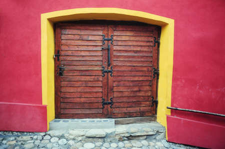 Old wooden double door in the Fortress Sighisoara, Transylvania, Romani