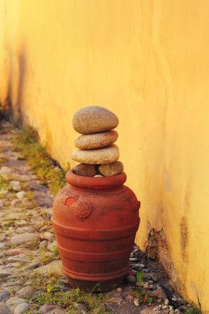 Decorative pottery on a cobblestone street in the city of Sighisoara, Transylvania, Romania