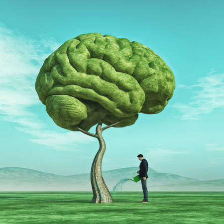 A imagem conceptual de um homem que esguincha uma árvore grande deu forma ao cérebro humano em um campo verde. Este é um 3d rende a ilustração. Foto de archivo
