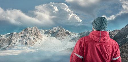Hiker admire mountain scenery winter. Stok Fotoğraf