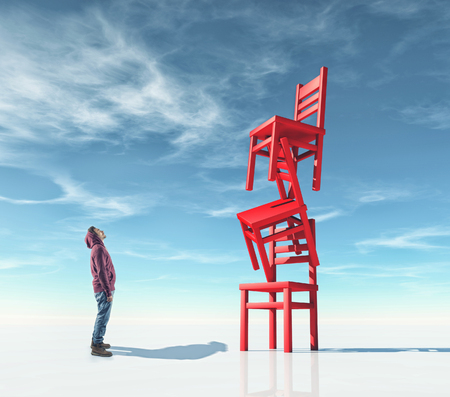 Young man in front of chairs in the balance. Aspiration concept.