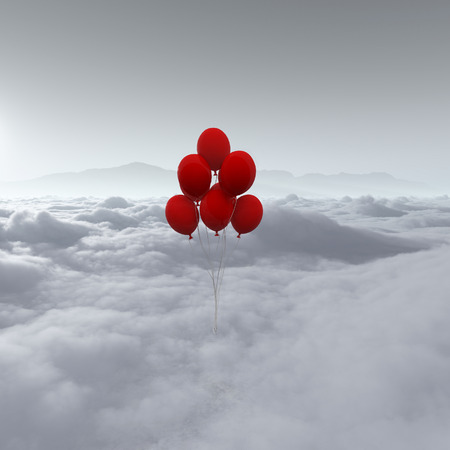 View of red balloons flying above clouds. Stockfoto