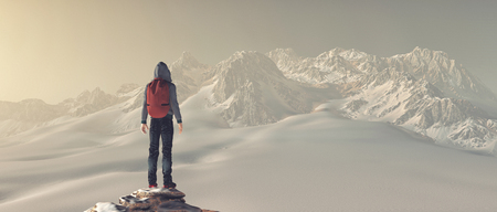 Hiker standing on a mountain cliff during winter. Stockfoto