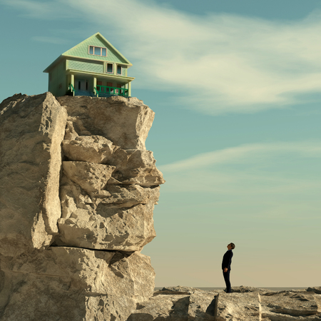 Man looks up to a mountain to a house. House at the edge of the mountain cliff. This is a 3d illustration. Stock Photo