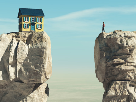 Man looks to a house over a gap between two mountain peaks. Stockfoto
