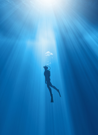 Scuba diver exploring  deep in the ocean. This is a 3d render illustration Stockfoto