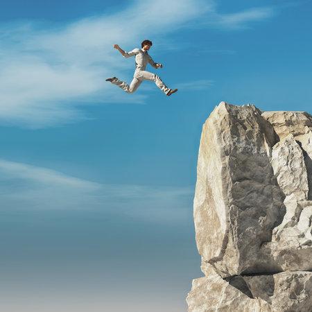 Man jumping to a high altitude mountain peak.