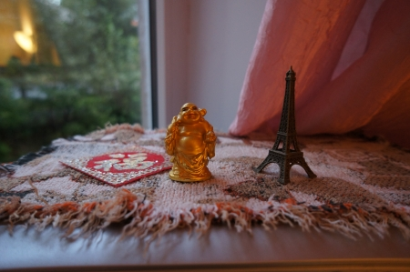 Original Japanese god and the Eiffel Tower on a napkin photo