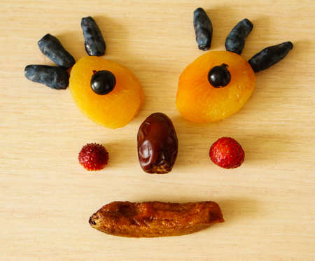 Edible man from dried apricots, currants, dates, dried banana, honeysuckle, strawberries