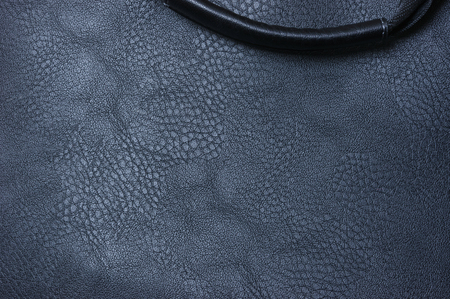 Fragment of a man's bag of artificial black leather