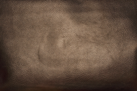 Fragment of a bag made of artificial brown leather