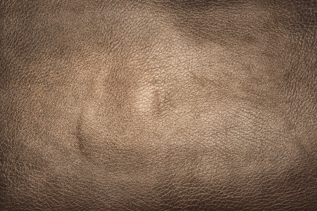 Piece of artificial brown leather