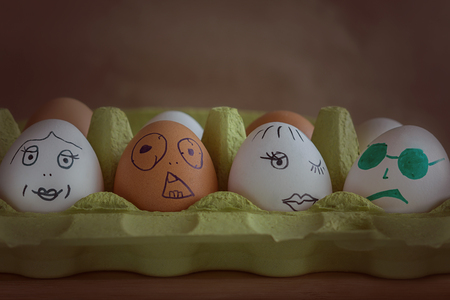 Different eggs with faces painted on them, symbolize the couples in the cinema Banco de Imagens