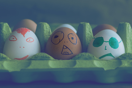 Different eggs with faces painted on them, symbolize the friends in the cinema Banco de Imagens