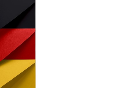 Black, red, yellow envelopes on the left of a white background symbolize the colors of the Federal Republic of Germany flag