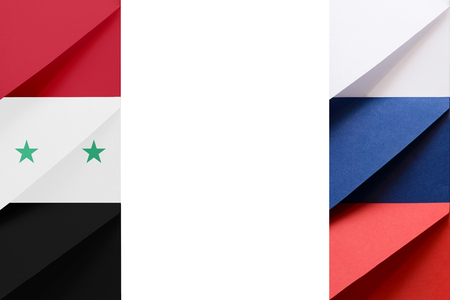Syrian Arab Republic and Russian Federation flags made from envelopes with blank space at the middle of picture symbolize international communication and cooperation Banco de Imagens