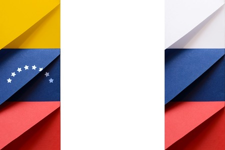 Bolivarian Republic of Venezuela and Russian Federation flags made from envelopes with blank space at the middle of picture symbolize international communication and cooperation Banco de Imagens
