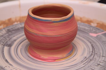 modeling: Clay pot on a potter wheel, modeling of pot hands, the sculpting of the hands Stock Photo