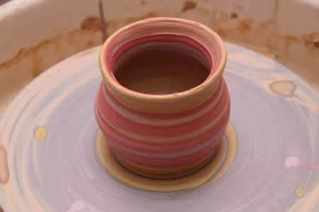 sculpting: Clay pot on a potter wheel, modeling of pot hands, the sculpting of the hands Stock Photo