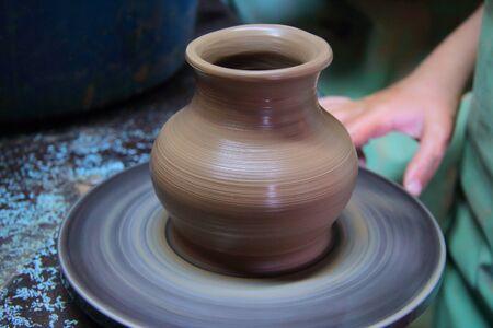 Clay pot on a pottery wheel