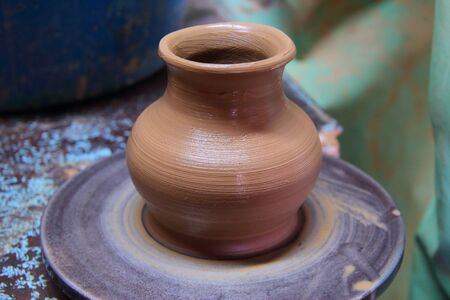 moulding: Clay pot on a pottery wheel