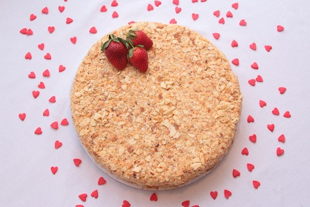 Cake Napoleon with strawberries isolated on a white background