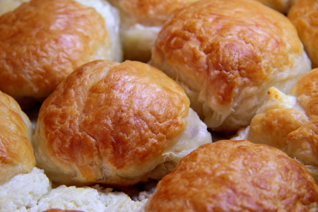 Baked sweet buns on a baking sheet with a ruddy crust, homemade delicious cakes. Фото со стока