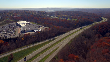 An aerial shot over a western Pennsylvania interstate in late Autumn. Editorial
