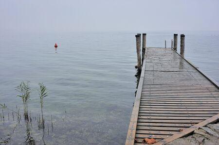 mist: Pier on a misty lake