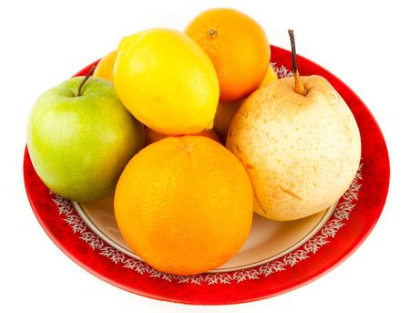 Ripe Fruit in a plate on a white background. photo