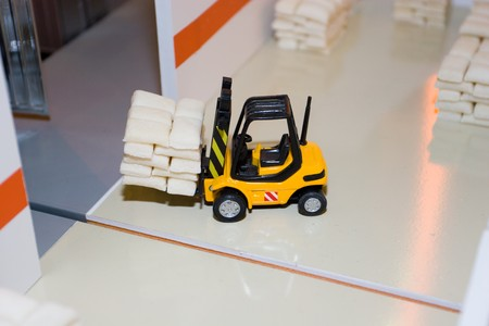 The forklift truck loader cargo in a toy warehouse. photo